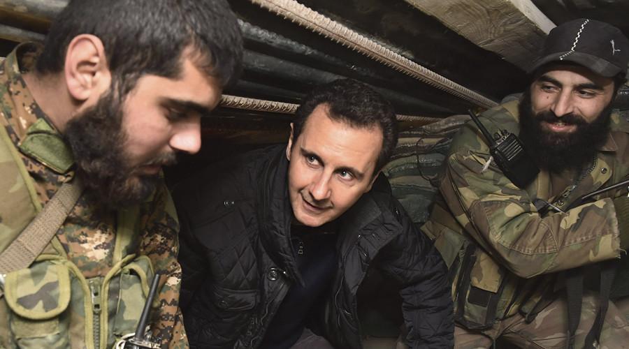 tong thong syria bashar al-assad (giua). anh: reuters