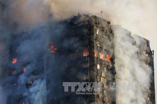 Thủ tướng Anh ra lệnh điều tra toàn diện vụ cháy chung cư - Ảnh 1